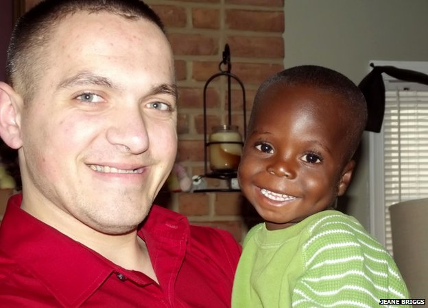 Joseph with Milo, one of the Briggs's adopted grandchildren