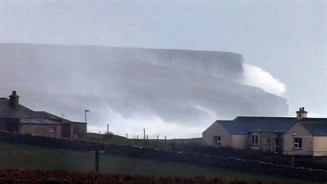 Waves crash on Orkney