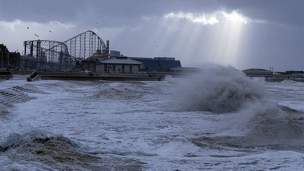 Waves crash onto the promenade on December 10, 2014 in Blackpool