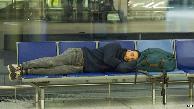 A passenger lying down at Gatwick