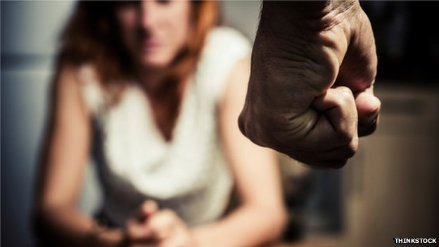 A man threatening a woman
