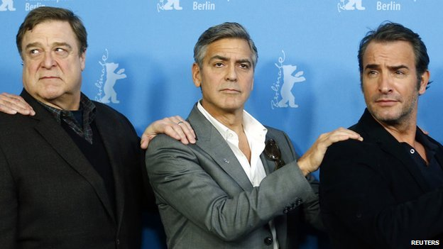 George Clooney with his Monuments Men co-stars John Goodman (l) and Jean Dujardin (r)