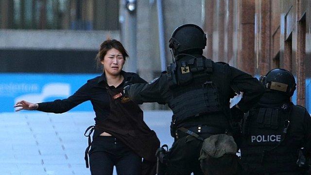 Hostage flees Sydney cafe siege