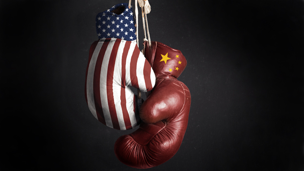 Two boxing gloves - one with the US flag and the other with the Chinese flag