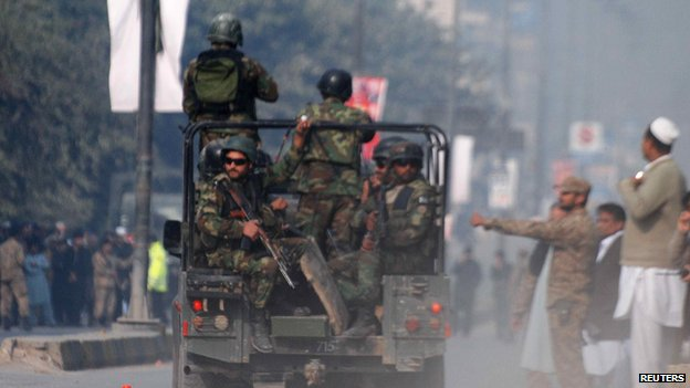 Pakistani troops at the scene