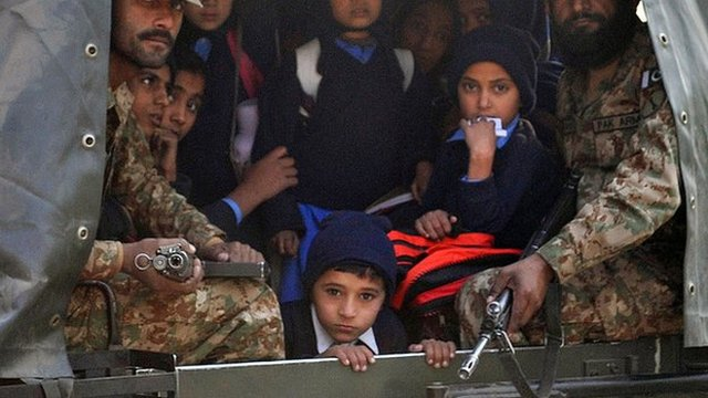 Children and soldiers in Pakistani army vehicle, Peshawar, 16 December 2014