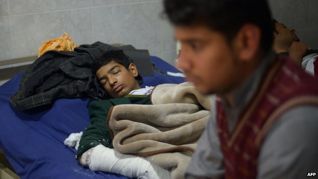 Wounded Pakistani student Mehran rests on a hospital bed in Peshawar. 17 Dec 2014