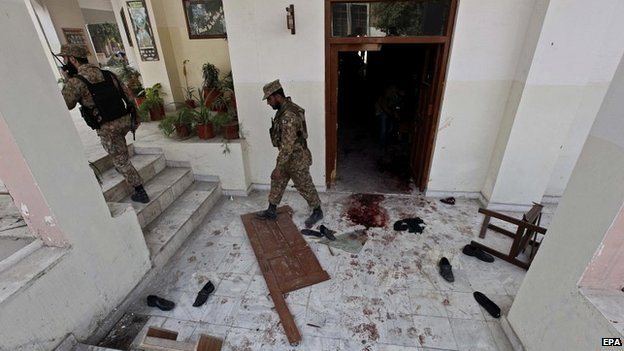 Pakistani security officials inspect the premises of the Army Public School that was attacked by Taliban militants in Peshawar - 17 December 2014