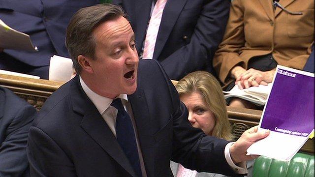 David Cameron waves Labour document at PMQs