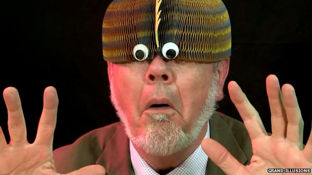 Tim Rowett wearing a funny hat