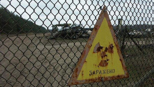 Warning sign on fence at Chernobyl