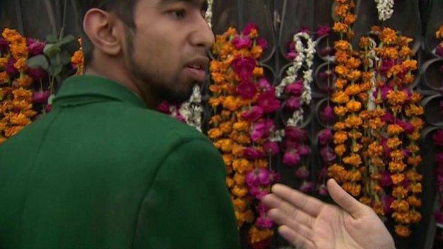 Pakistan school attack survivor Aqif Azeem shows BBC reporter faint blood stains on his school uniform