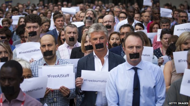 BBC journalists hold one-minute silent protest outside New Broadcasting House against the seven-year jail terms given to three al-Jazeera journalists in Egypt on 24 June 2014 in London, England.