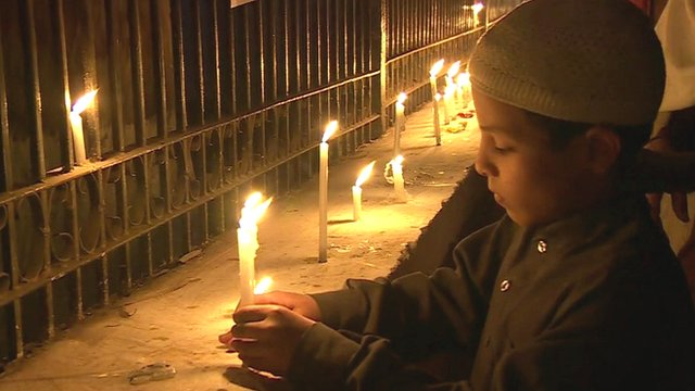 Boy lighting candles