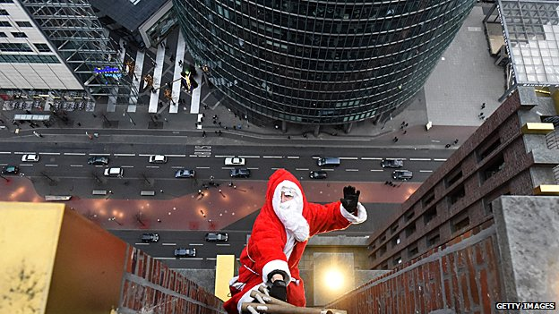 Santa Claus lost on the side of an office block