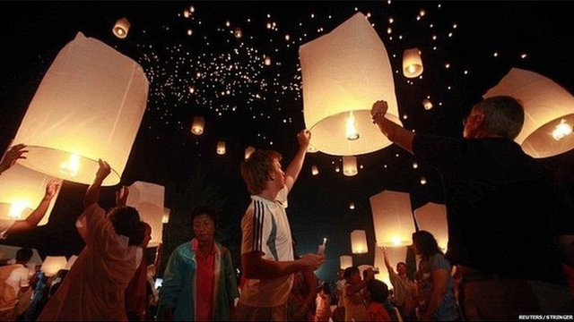 Mourners launch thousands of floating paper lanterns into the sky in remembrance of the 2004 Indian Ocean tsunami victims