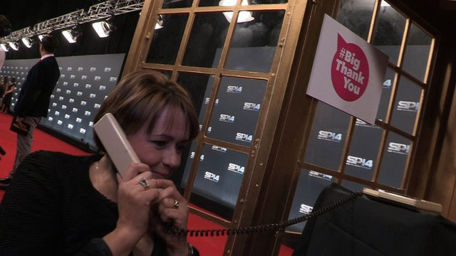 Tanni Grey-Thompson on the phone outside a phone box