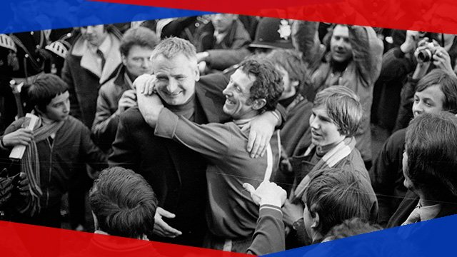 Colchester manager Dick Graham celebrates with his players after defeating Leeds