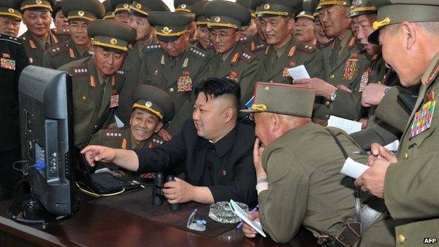 North Korean leader Kim Jong-un looks at a computer, surrounded by army chiefs - 27 April 2014
