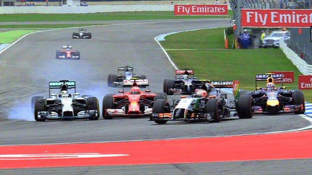 Lewis Hamilton passes Kimi Raikkonen and Daniel Ricciardo at the German Grand Prix