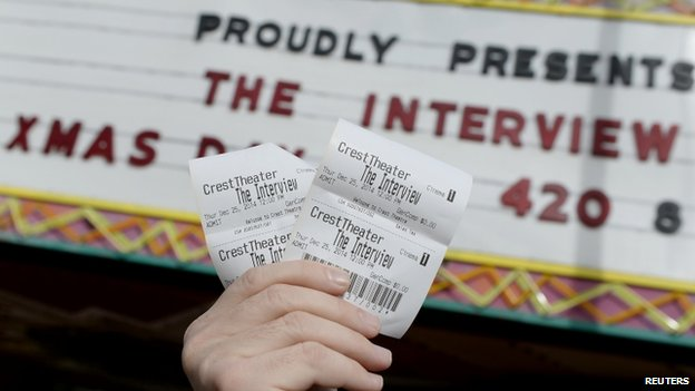 Tickets for The Interview held up outside Crest Theatre in Los Angeles, California. 24 Dec 2014
