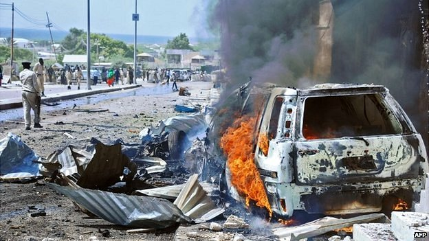 The aftermath of a bomb blast near Mogadishu's international airport in Somalia - 3 December 2014