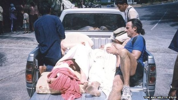 Injured people in the back of a pick-up truck