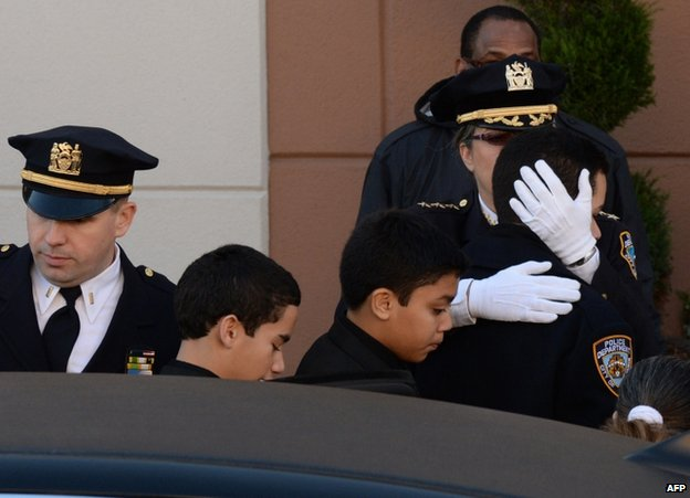 Ramos family members arrive for the funeral in New York, 27 December