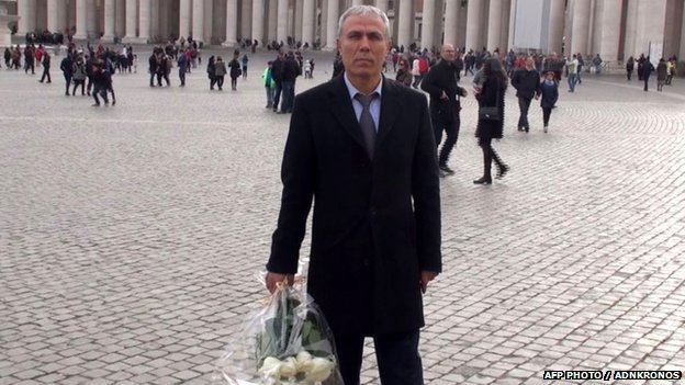 Mehmet Ali Agca holding a wreath of flowers on St. Peter's square in The Vatican from Adnkronos TV on 27 December 2014
