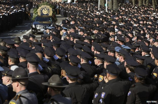 Police salute the hearse in New York, 27 December