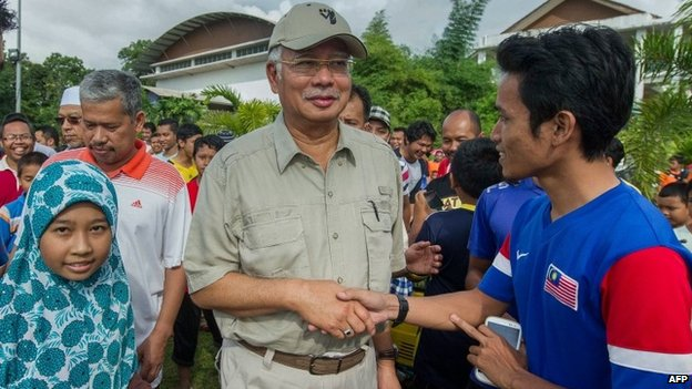 The Malaysian Prime Minister, Najib Razak, at an evacuation centre following heavy flooding in the country