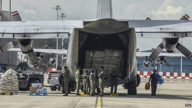 The Malaysian air force prepares goods to be sent to victims of the flooding