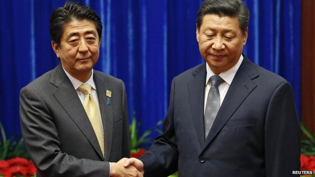China's Xi Jinping shakes hands with Japanese Prime Minister Shinzo Abe during their meeting at the Great Hall of the People, on the sidelines of the Asia Pacific Economic Cooperation (APEC) meetings, in Beijing in this 10 November, 2014 file photo