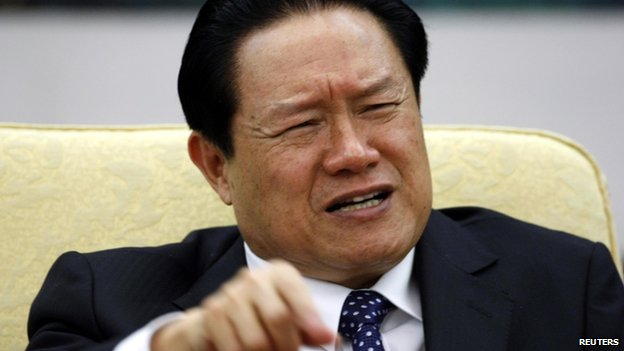 China's former Public Security Minister Zhou Yongkang gestures as he attends Hebei delegation discussion sessions of the 17th National Congress of the Communist Party of China in Beijing, in this 2007 file photo