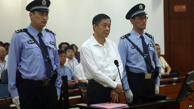 In this file photo released by the Jinan Intermediate People's Court, former Politburo member and Chongqing city party leader Bo Xilai stands on trial at the court in eastern China's Shandong province