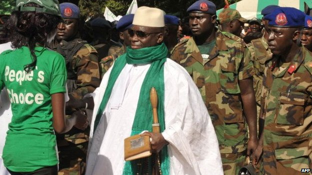 The Gambia's President Yahya Jammeh greets his supporters at a rally on 22 November 2011