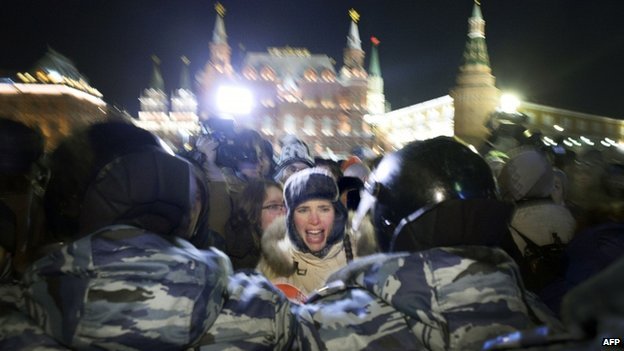 A woman screams during a rally in support of Russian opposition leader Alexei Navalny and his brother Oleg Navalny in central Moscow on 30 December 2014