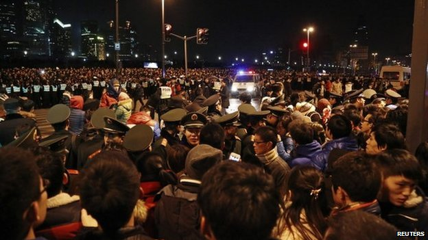 """Police control the site after a stampede occurred during a New Year""""s celebration on the Bund, a waterfront area in central Shanghai, 1 January 2015."""