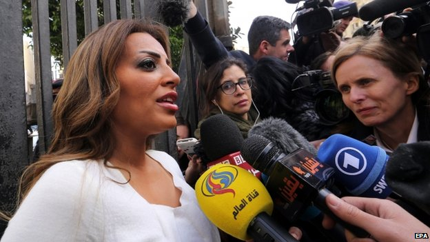 Marwa Omara (left), fiancee of imprisoned al-Jazeera Egyptian-Canadian journalist Mohamed Fahmy, speaks to the press outside the High Court (01 January 2015)