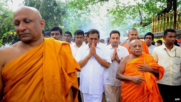 Maithripala Sirisena visits a Buddhist temple