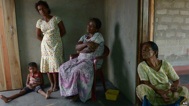 Tamil widow Vathana Baaskari and her relatives discuss the war