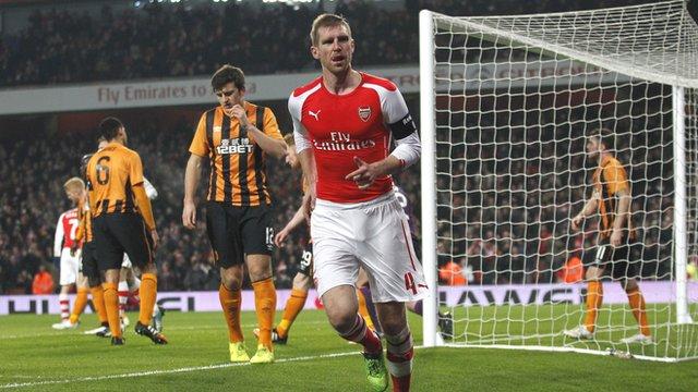 Per Mertesacker celebrates after scoring for Arsenal against Hull