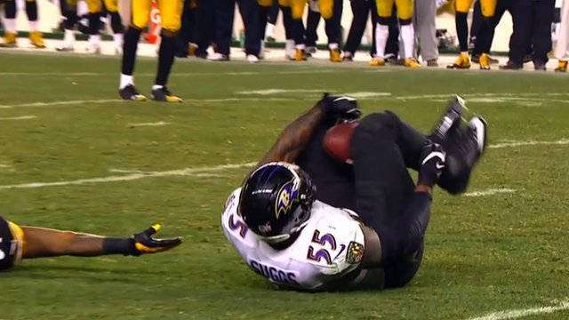 Terrell Suggs catches an interception between his knees