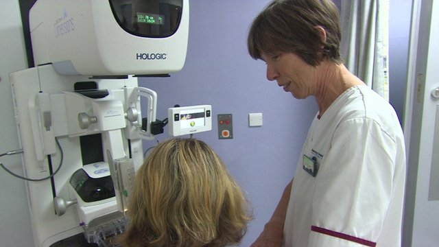 Medical worker giving patient scan for cancer