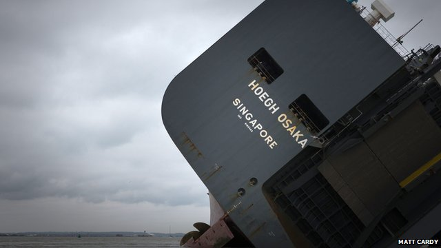Close up of stranded ship the Hoegh Osaka on her side on a sandbank in the Solent