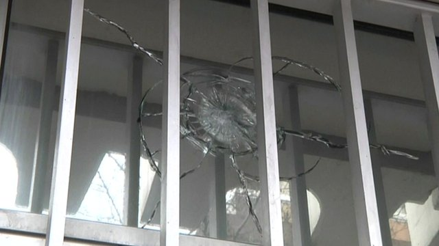 Glass with bullet hole