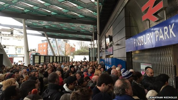 Crowds of people outside barricaded entrance to Finsbury Park train station