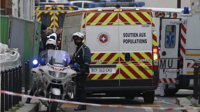 Police block road at Charlie Hebdo offices