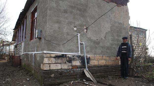 Shrapnel-damaged wall in Gazyan
