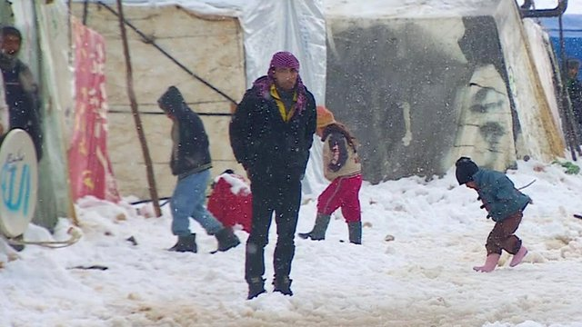 Syrian refugees in snow